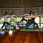 Teaching Virabhadrasana II (Warrior II) pose during a yoga retreat